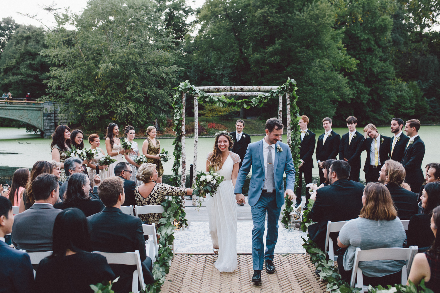 Couple walks up the aisle after their wedding ceremony at Prospect Park Boat House