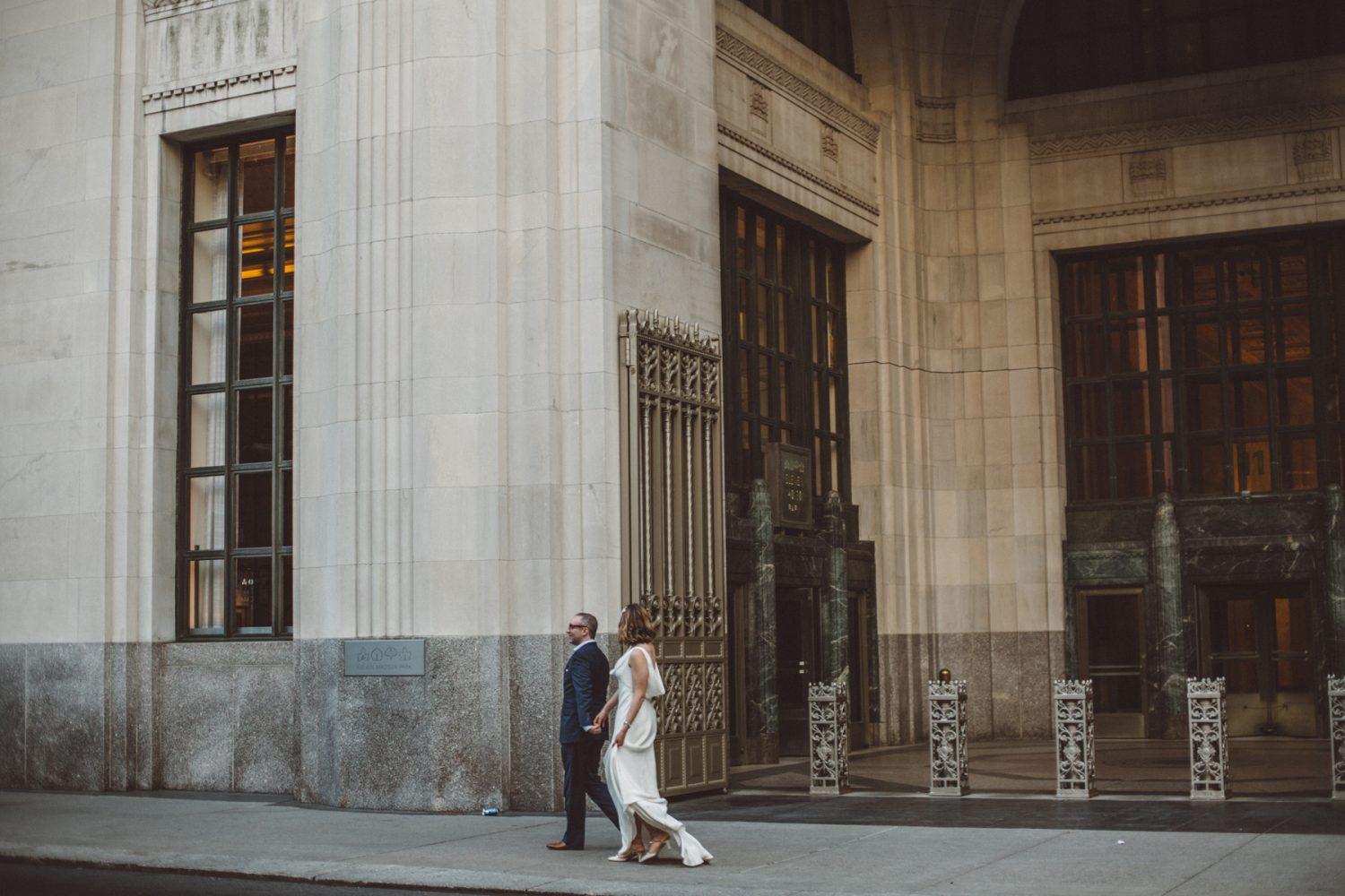 couple walking down madison ave from their wedding at eleven madison