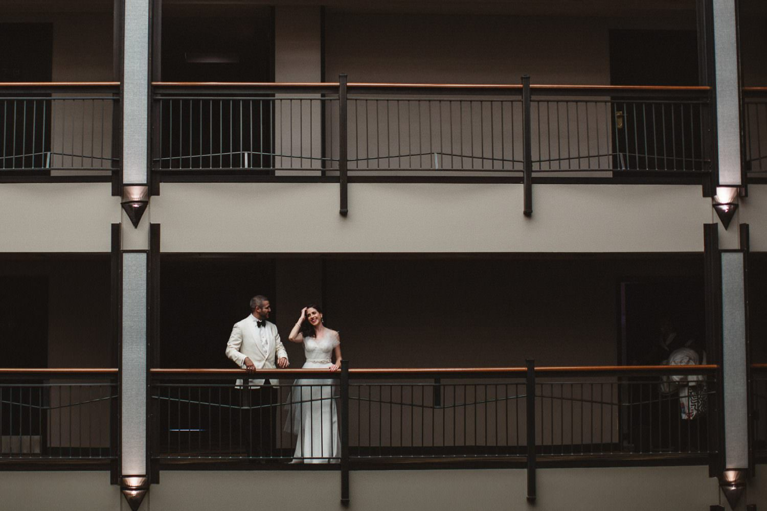 Bride and Groom on the balcony at the Roxy Hotel getting ready to head to their wedding ceremony at Frankies 457 in Brooklyn, NY