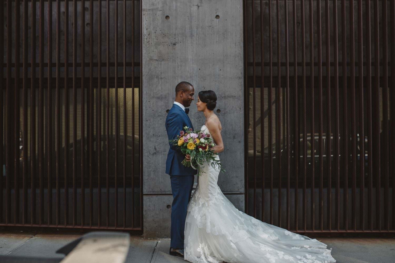 Bride and Groom standing near 26 Bride in Brooklyn