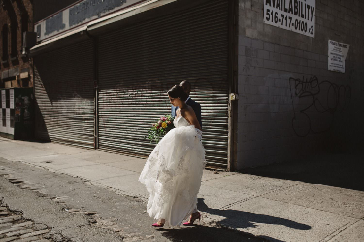 Bride and Groom walking on a sunny street in Brooklyn