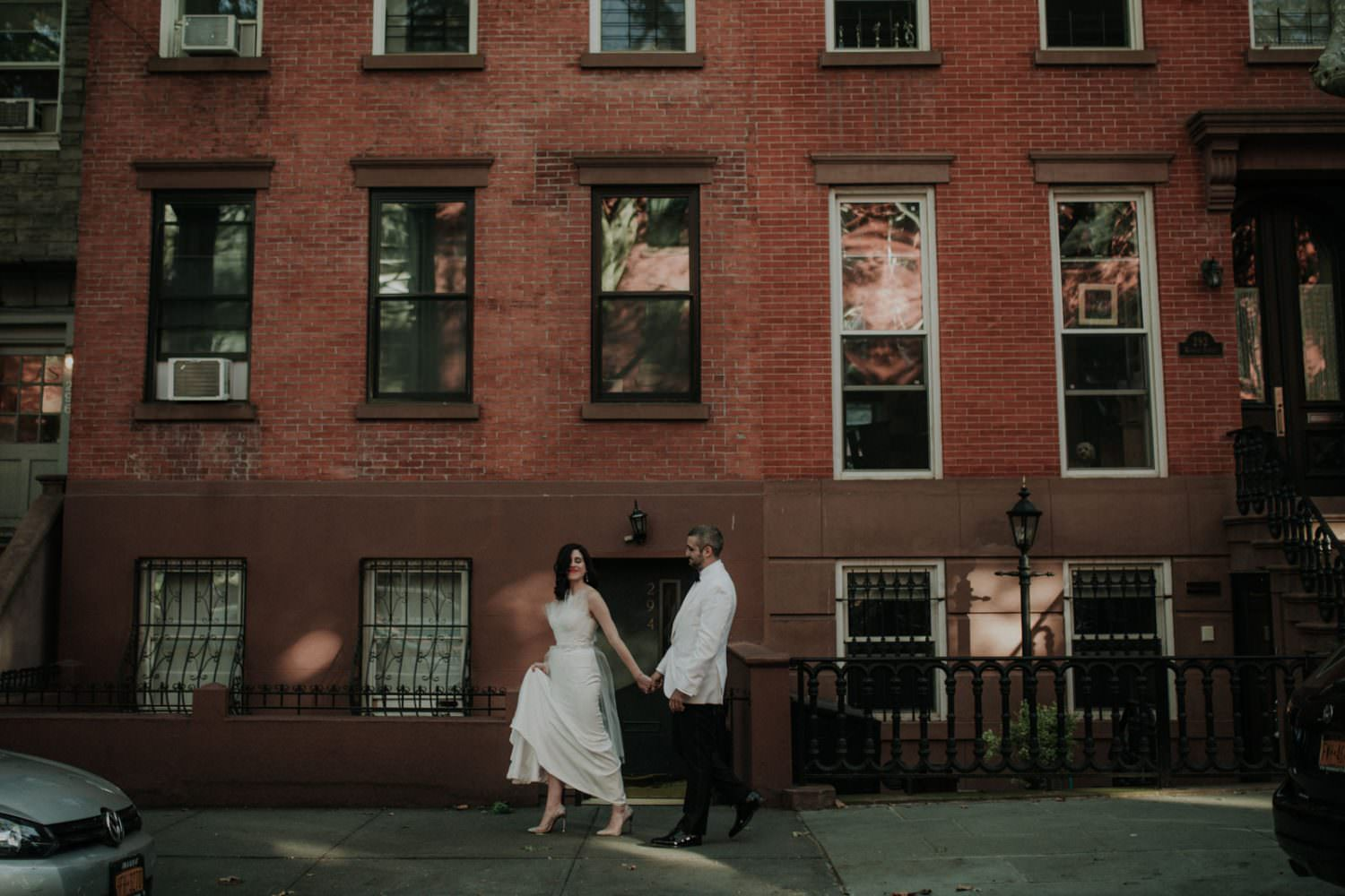 Brooklyn couple walking to their wedding at Frankies 457