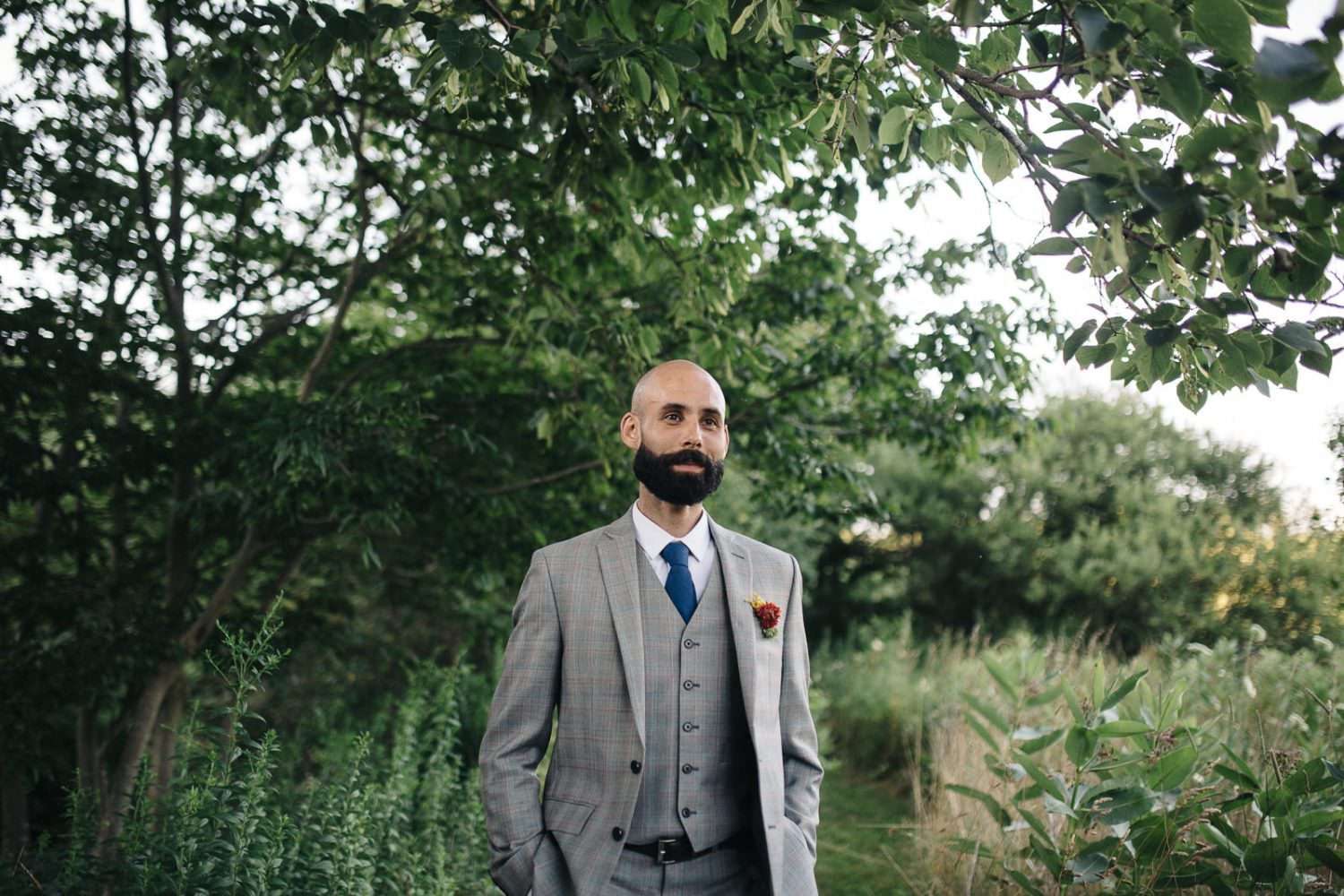 Groom standin in the catskill mountains in New York