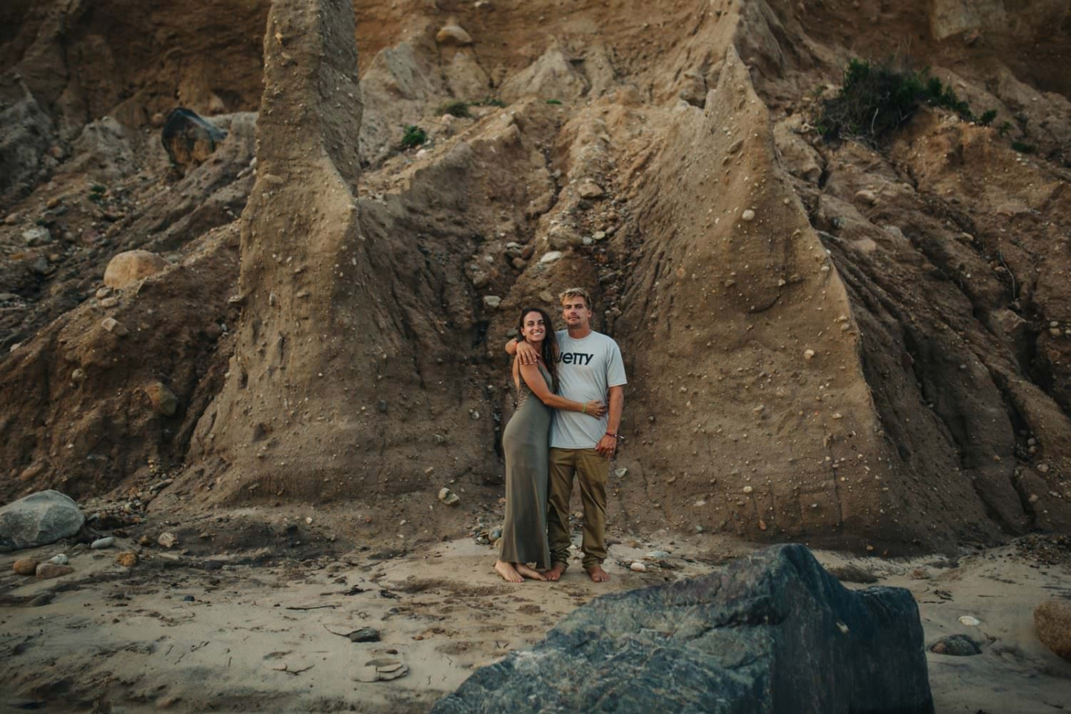 couple standing in front of cliffs in mountauk, ny