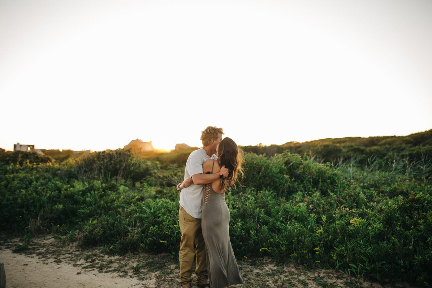 Couple hugging close during Montauk engagement shoot