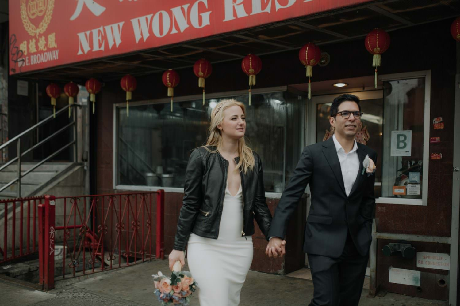Bride and Groom walk in Chinatown on the way to city hall to get married