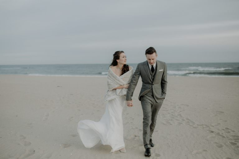 Bride and Groom walk holding hands after their Gurney's Montauk Wedding