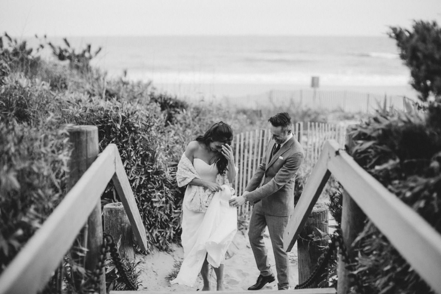 Bride and Groom walking up the steps at Gurney's Montauk