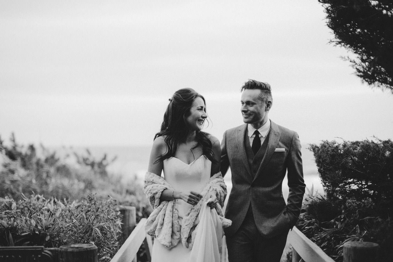 Black and White image of Bride and Groom staring at each other after a beach photo session in Montauk, New York