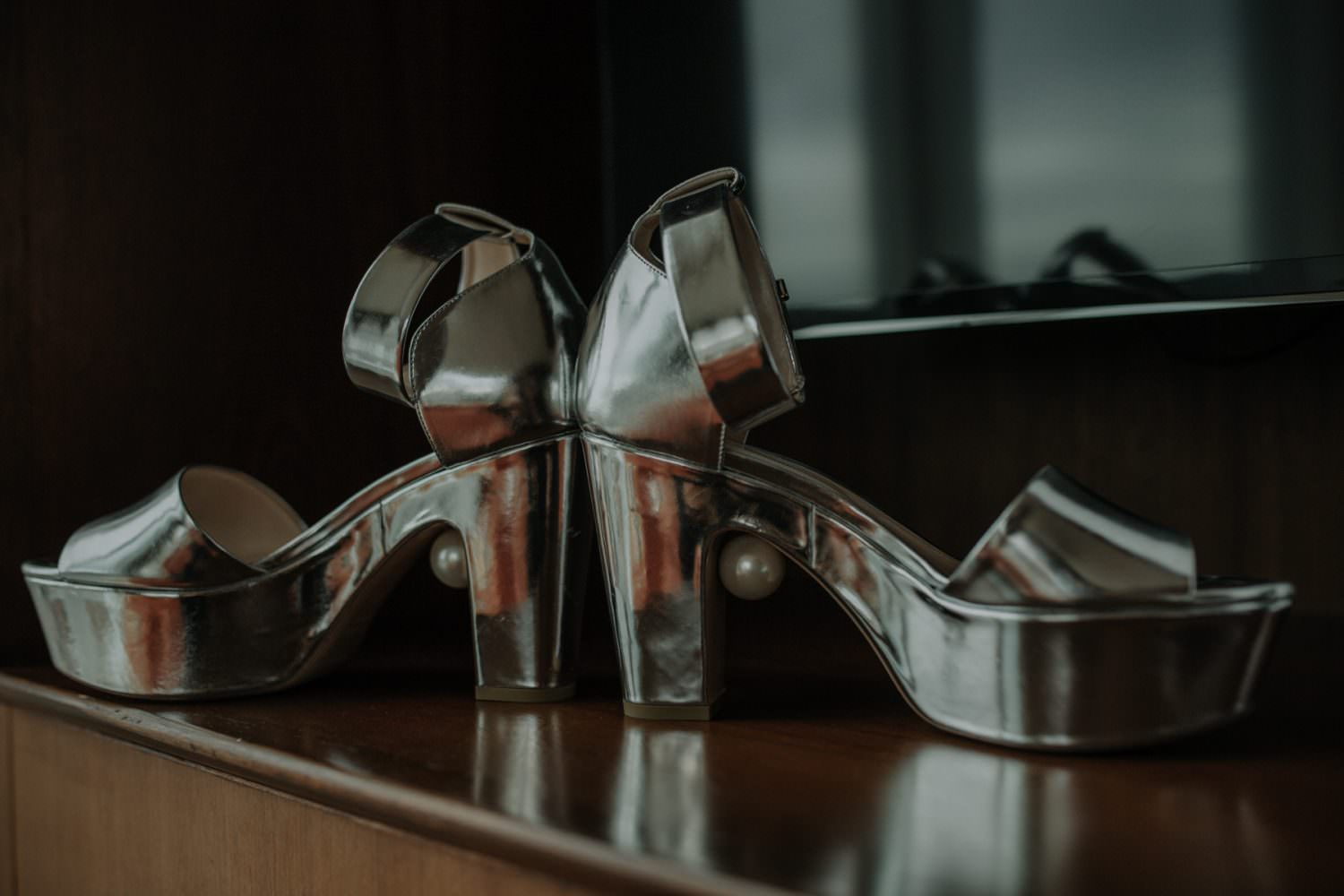 Close up photo of Bride's silver Nicholas Kirkwood Platforms