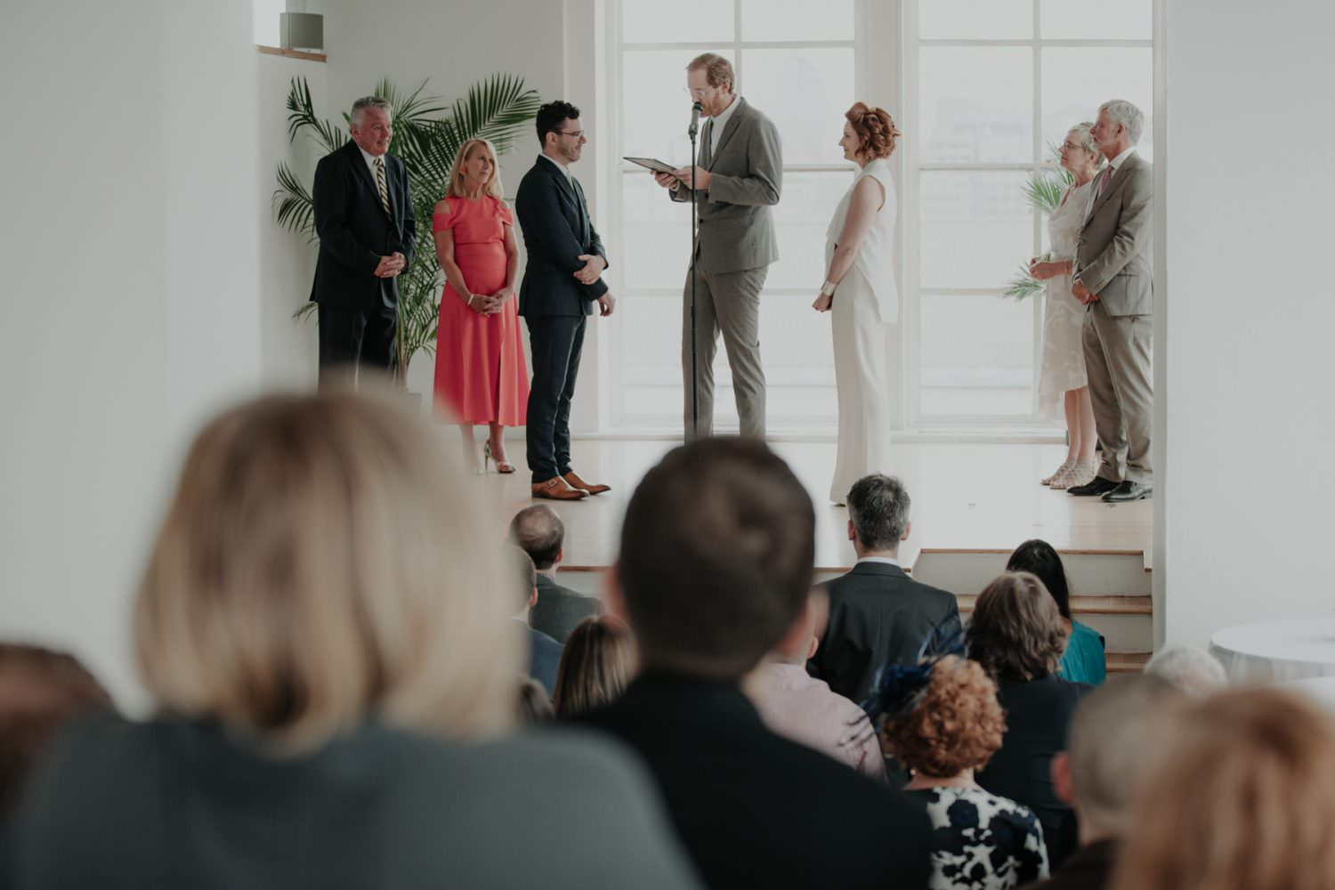 Bride and Groom looking at each other on the stage during their wedding ceremony
