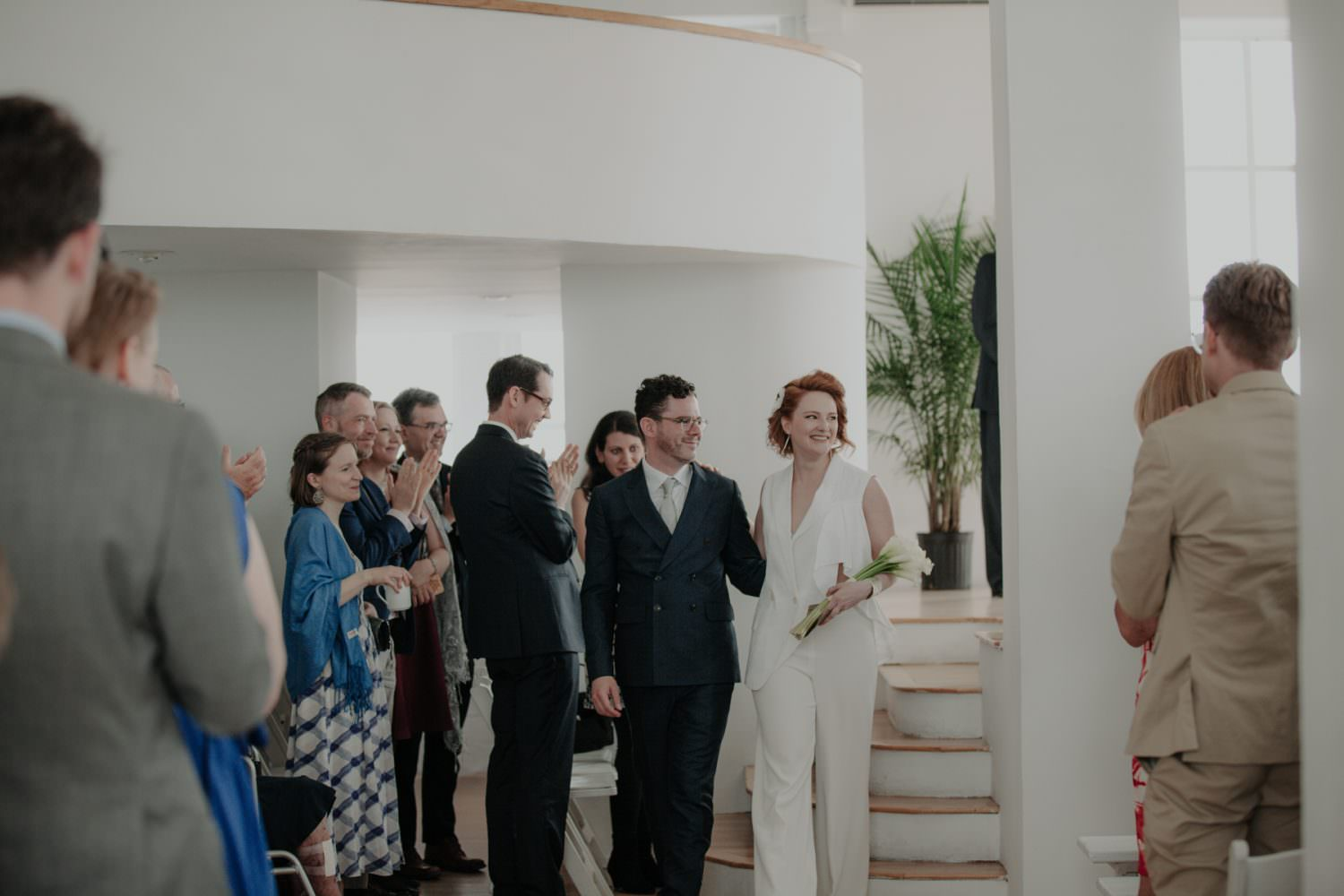Bride and Groom make an exit after their wedding ceremony