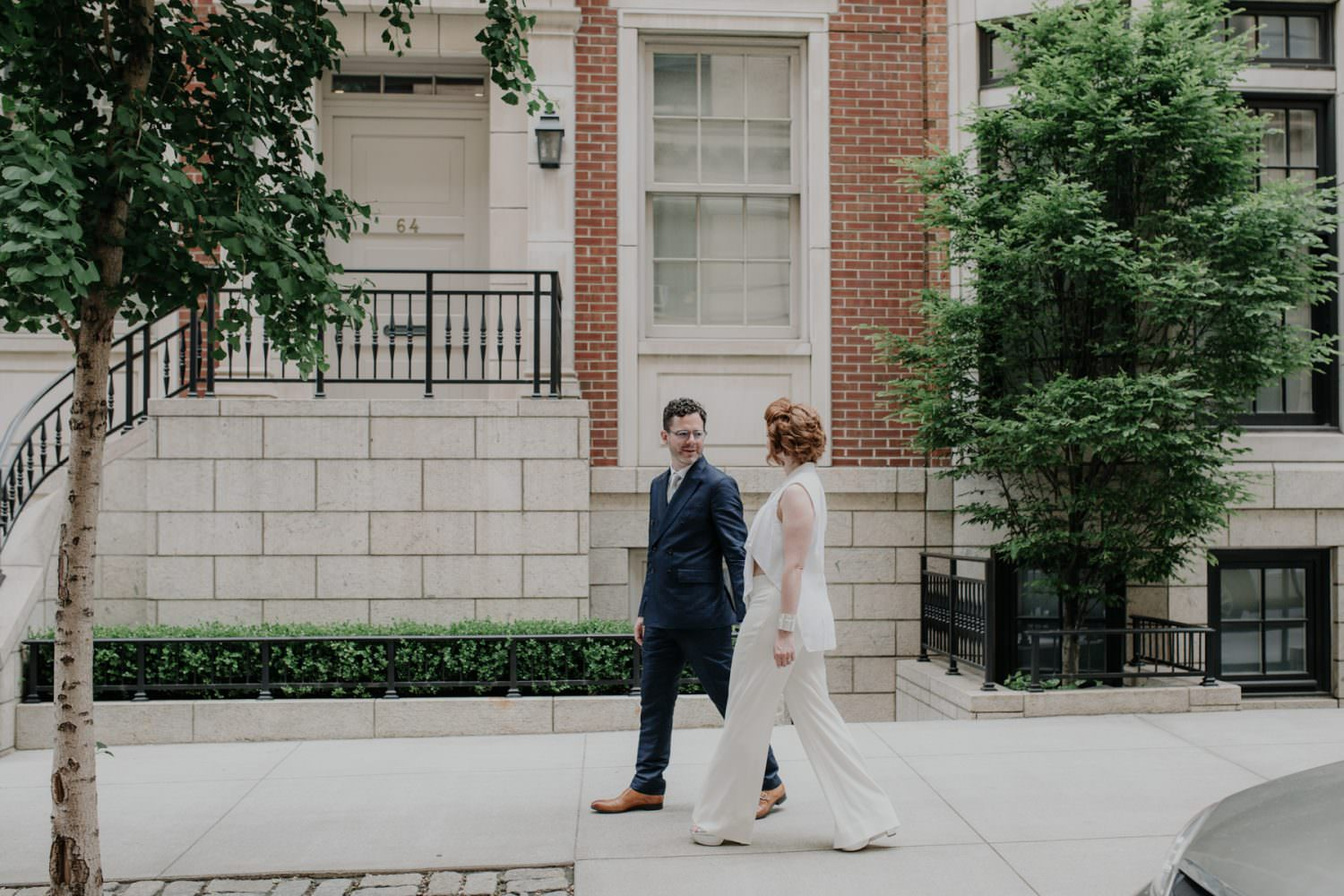 Groom looking at his Bride while walking the streets of NYC