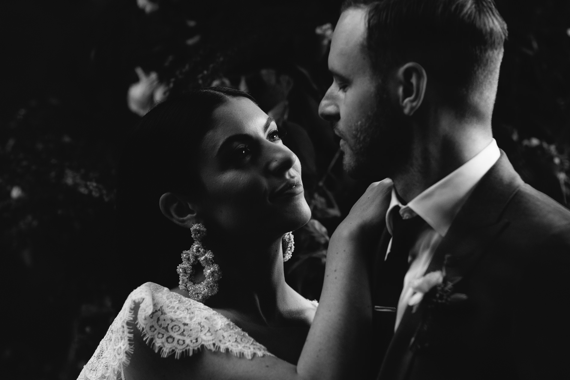 Bride and Groom staring at each other in dark dramatic lighting