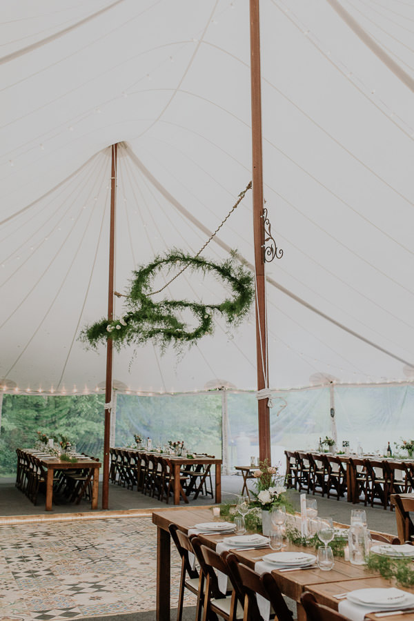 vertical image of dinner set up inside the tent at Foxfire Mountain House