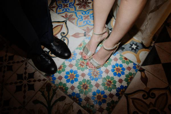 Bride and Grooms feet on the colorful tiles after a night off dancing on their wedding day at foxfire mountain house