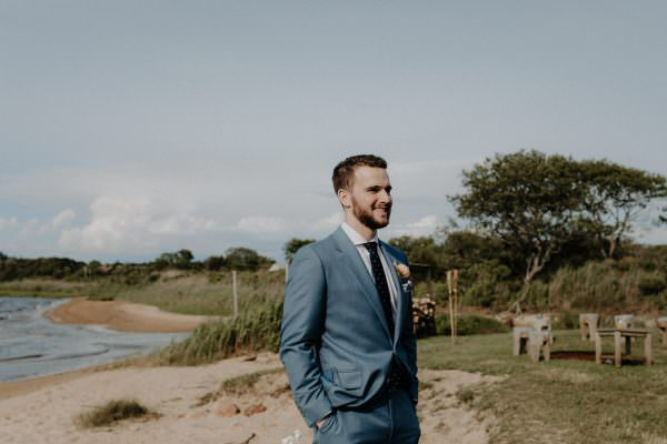 Image of a groom looking into the distance during his wedding ceremony