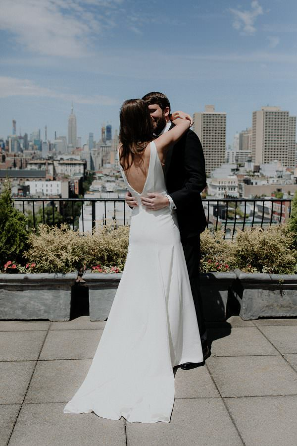 Bride and Groom hug after they first see each other on the hotel balcony at SIXTY SOHO