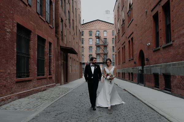 Bride and Groom walk down the streets of Tribeca on their wedding day in New York