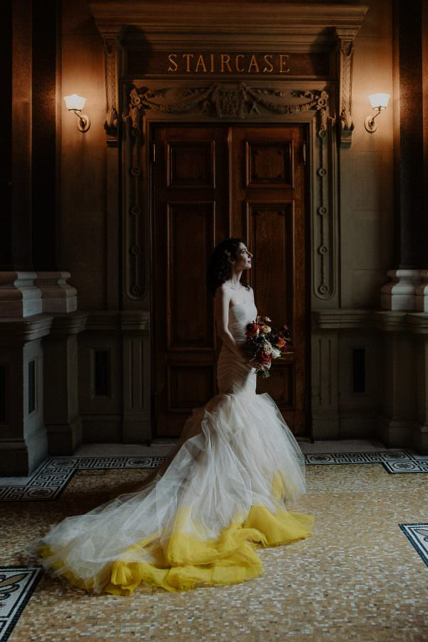 Portrait of a bride on her wedding day showcasing her beautiful yellow Vera Wang dress